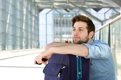 Cool traveler waiting at airport with bag Stock Image