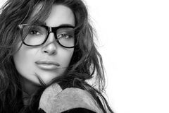 Cool Trendy Eyewear. Beauty Fashion Young Woman in Glasses. Gorgeous brunette fashion model girl with casual hairstyle wearing trendy glasses. Cool trendy Stock Photos
