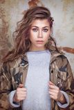 Cool trendy girl in camouflage jacket stock photography