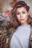 Cool trendy girl in camouflage jacket Royalty Free Stock Photo