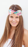 Cool trendy girl with a flowered hair scarf Royalty Free Stock Photos