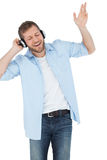 Cool trendy model listening to music and singing Royalty Free Stock Images