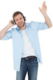 Cool trendy model listening to music and smiling Royalty Free Stock Photography