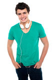 Cool trendy teenager boy with headphones. Around his neck. Posing casually and smartly Royalty Free Stock Photography