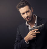 Cool undercover agent with gun Royalty Free Stock Image