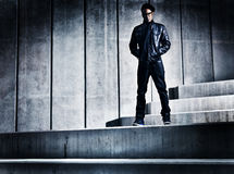 Cool urban african american man on distopic concrete steps Royalty Free Stock Photos