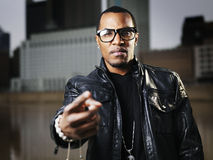 Cool urban guy with glasses. Cool urban african american guy making hand sign Royalty Free Stock Photo