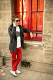 Cool urban guy talking on the phone. In red colors Stock Photography