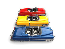 Cool vintage power cars - primary colors - side view Royalty Free Stock Photography