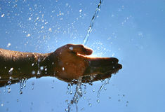 Cool water. Cool fresh water falling on a man's hands