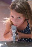 Cool Water. Little girl taking a drink of water from fountain Royalty Free Stock Photo