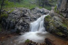 Cool water. An Arizona monsoon powered waterfall with a pool of water at the bottom Royalty Free Stock Photo