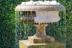 Cool water flowing from an old antique fountain Stock Photos