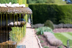 Cool water flowing from an old antique fountain Stock Images