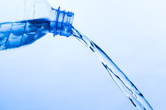 Cool Water Pouring from a Transparent Plastic Bottle Stock Images