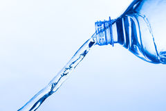 Cool Water Pouring from a Transparent Plastic Bottle Stock Photos