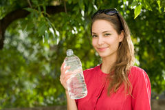 Cool water refreshment. Cool water refreshment, portrait of a beautiful young brunette with bottled water stock photography