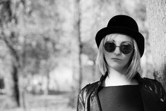 Cool woman in a black jaket. Black and white photo Stock Photo