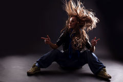 Cool woman dancer. Against black background Royalty Free Stock Photo