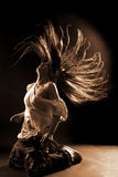 Cool woman dancer. Against black background Stock Photography