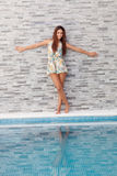 Cool woman on the edge of the pool Royalty Free Stock Images
