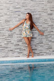 Cool woman on the edge of the pool Royalty Free Stock Photography