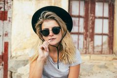 Cool woman with glasses and lollipop stock photography