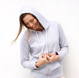 Cool woman laughing with hood sweatshirt Royalty Free Stock Photos