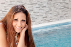 Cool woman lying on the edge of the pool Stock Photography