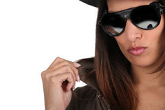Cool woman in shades. And a leather jacket Stock Photos