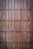 Cool wood door with nails Royalty Free Stock Images