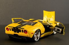 Cool Yellow sports car. Picture of a toy car. Focus is centered around the tail light area Stock Photos