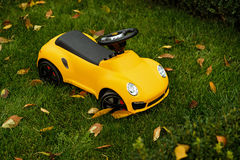 Cool yellow toy car for toddler Royalty Free Stock Photography