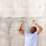 Cool young African american man pointing fingers up Stock Images
