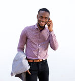 Cool young african guy talking on cellphone Stock Image