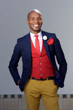 Cool young african man in fashionable suit smiling outdoors Royalty Free Stock Photography