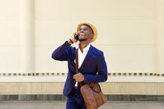 Cool young african man talking on mobile phone Royalty Free Stock Photography