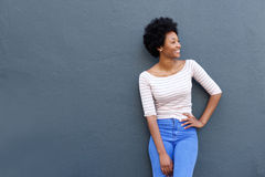 Cool young african woman smiling against gray background Royalty Free Stock Photography