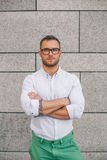 Cool young bearded hipster man wearing shirt, keeping arms crossed Royalty Free Stock Photos
