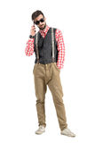 Cool young bearded hipster talking on the mobile phone Royalty Free Stock Image