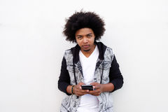 Cool young black guy with mobile phone Stock Photos