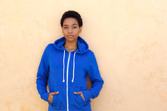 Cool young black woman with blue sweatshirt. Portrait of cool young black woman with blue sweatshirt Stock Photos