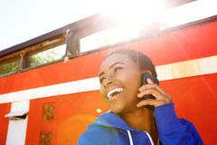 Cool young black woman laughing with cellphone Stock Photos