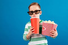 Cool Young boy in eyeglasses preparing to watch the film Royalty Free Stock Photography