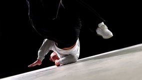 Cool young break dancer dancing on black background stock video