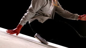 Cool young break dancer dancing on black background stock video footage