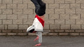 Cool young break dancer doing a handstand stock footage