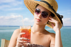Cool young brunette on holiday. Stock Images
