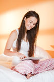 Cool young brunette using tablet. Stock Images