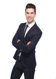 Cool young business man smiling with arms crossed. Portrait of a cool young business man smiling with arms crossed on isolated white background Stock Image